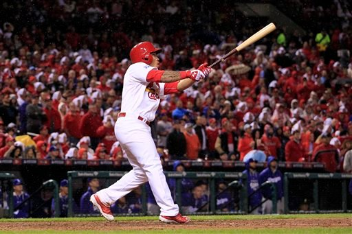 St. Louis Cardinals' Kolten Wong reacts as he hits a two-run home run during the seventh inning of Game 3 of baseball's NL Division Series against the Los Angeles Dodgers, Monday, Oct. 6, 2014, in St. Louis. (AP Photo/Jeff Roberson)