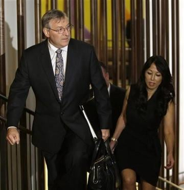 Terry and Kim Pegula arrive for a meeting of NFL owners and executives in New York, Wednesday, Oct. 8, 2014.