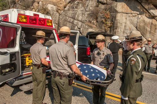 Yosemite National Park Rangers transfer the body of a Cal Fire pilot who was killed in an airplane crash in Yosemite National Park, Calif., on Wednesday, Oct. 8, 2014. (AP)