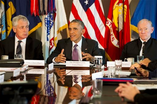 President Barack Obama, flanked by Defense Secretary Chuck Hagel, left, and Joint Chiefs Chairman Gen. Martin Dempsey, speaks to the media at the conclusion of a meeting with senior military leadership, Wednesday, Oct. 8, 2014, at the Pentagon. (AP Photo)