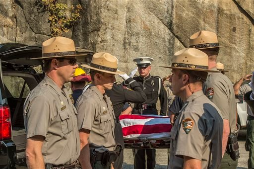 Yosemite National Park Rangers transfer the body of a Cal Fire pilot who was killed in an airplane crash in Yosemite National Park, Calif., on Wednesday, Oct. 8, 2014. (AP Photo/Al Golub)