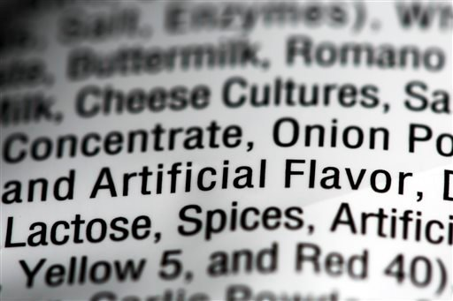 "This Sept. 26, 2014 photo shows the ingredients label on a bag of Nacho Cheese flavored Doritos, in Philadelphia. ""Artificial and natural flavors"" have become ubiquitous terms on food labels. (AP Photo/Matt Rourke)"