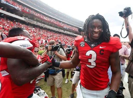 Georgia running back Todd Gurley (3) celebrates with linebacker Amarlo Herrera (52) after an NCAA college football game against Tennessee Saturday, Sept. 27, 2014, in Athens, Ga.
