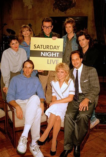 "In this Dec. 9, 1986 file photo, the cast of NBC's ""Saturday Night Live,"" clockwise, from left, Nora Dunn, Jan Hooks, Phil Hartman, Dana Carvey, Dennis Miller, Jon Lovitz, Victoria Jackson, and Kevin Nealon, pose together, in New York."