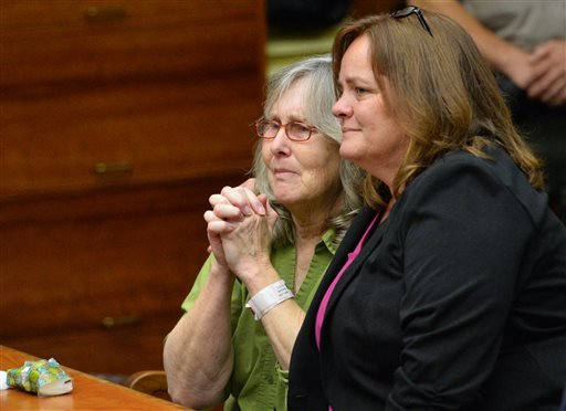 Susan Mellen, left, sits with her attorney Deirdre O'Connor, as she is exonerated of murder by Superior Court Judge Mark Arnold in Torrance, Calif., Friday, Oct. 10, 2014. (AP)