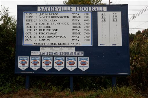 A roadside sign displays the Sayreville War Memorial High School football team schedule on Main Street in Sayreville, N.J., Saturday, Oct. 11, 2014.