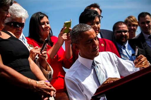 President Barack Obama is joined on stage by local supporters as he signs an executive order designating the San Gabriel Mountains National Monument, at Frank G. Bonelli Regional Park in San Dimas, Calif., Friday, Oct. 10, 2014.