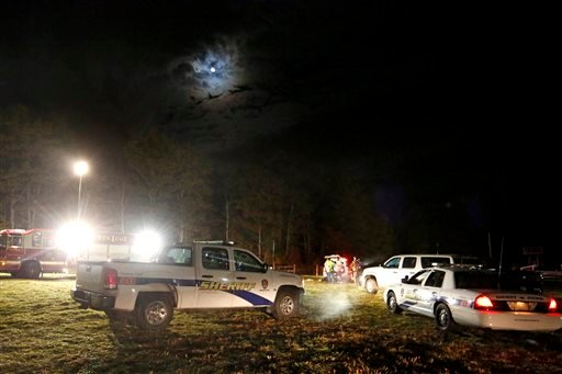 Emergency personnel work at the site of a hayride rollover that injured multiple people Harvest Hill Farms in Mechanic Falls on Route 126, Saturday, Oct. 11, 2014.