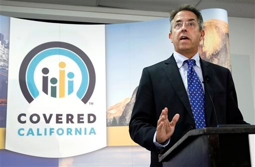 In this Nov. 13, 2013 file photo, Peter Lee, executive director of Covered California, the state's health insurance exchange, talks at a news conference in Sacramento, Calif.