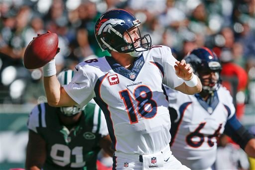 Denver Broncos quarterback Peyton Manning (18) throws against the New York Jets in the first quarter of an NFL football game, Sunday, Oct. 12, 2014, in East Rutherford, N.J. (AP Photo/Kathy Willens)
