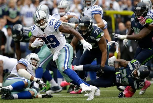 Dallas Cowboys running back DeMarco Murray (29) runs for a touchdown in the second half of an NFL football game against the Seattle Seahawks, Sunday, Oct. 12, 2014, in Seattle. (AP Photo/Elaine Thompson)
