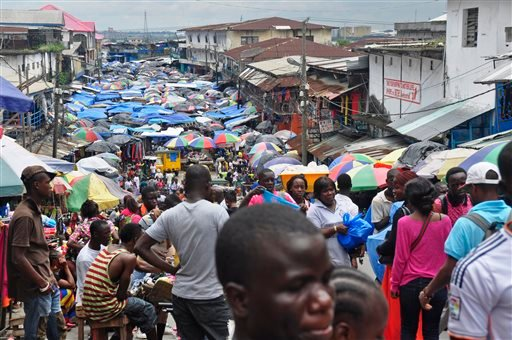 In this Aug. 19, 2014 file photo, people do business at the Waterside local market in the center of Monrovia, Liberia.