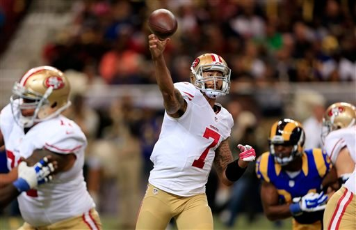 San Francisco 49ers quarterback Colin Kaepernick (7) passes against the St. Louis Rams in the first quarter of an NFL football game Monday, Oct. 13, 2014, in St Louis. (AP Photo/Billy Hurst)