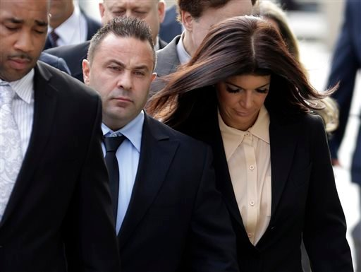 """Oct. 2, 2014, file photo: """"The Real Housewives of New Jersey"""" stars Giuseppe """"Joe"""" Giudice, center, and his wife, Teresa Giudice, right, of Montville Township, N.J., walk toward the Martin Luther King Jr. Courthouse in Newark, N.J. (AP Photo/Julio Cortez)"""