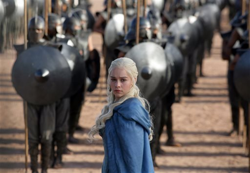 "This file publicity image released by HBO shows Emilia Clarke as Daenerys Targaryen in a scene from ""Game of Thrones."""