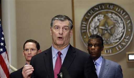 Dallas Mayor Mike Rawlings, center, speaks as Dallas County Judge Clay Jenkins, left, and Zachary Thompson, the director of Dallas County Health and Human Services, look on during a news conference announcing a second Ebola infection.