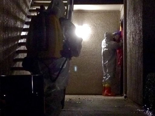 This photo posted on Twitter by the City of Dallas Public Information Managing Director Sana Syed, members of Dallas Fire-Rescue Haz Mat Unit tape off the door at the The Village Bend East apartment of a second healthcare worker who has tested positive.