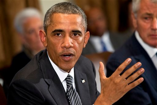 President Barack Obama speaks about Ebola after a meeting in the Cabinet Room of the White House in Washington, Wednesday, Oct. 15, 2014, with members of his team coordinating the government's response to the Ebola outbreak. (AP Photo/Jacquelyn Martin)