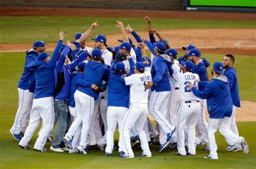 The Kansas City Royals players celebrate after the Royals defeated the Baltimore Orioles 2-1 in Game 4 of the American League baseball championship series Oct. 15, 2014, in Kansas City, Mo. (AP Photo/Michael Conroy)