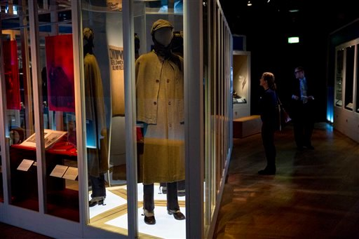"""To showcase Sherlock Holmes as a fashion icon a great coat and deerstalker hat dated from around 1950 are displayed as part of the exhibition """"Sherlock Holmes: The Man Who Never Lived and Will Never Die."""". (AP Photo/Matt Dunham)"""