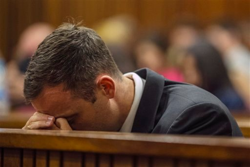 Oscar Pistorius sits in court for the last day of his sentencing hearing in Pretoria, Friday, Oct. 17, 2014.