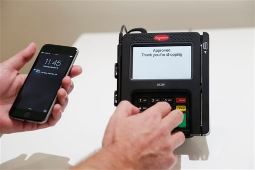 Apple Pay is demonstrated at Apple headquarters on Thursday, Oct. 16, 2014 in Cupertino, Calif.