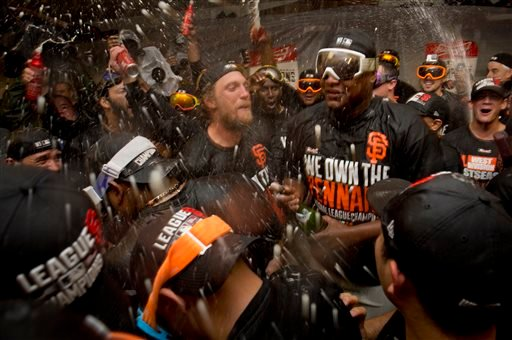 San Francisco Giants' Hunter Pence, center left, leads the team in a cheer during the celebration in the locker room after the Giants defeated the St. Louis Cardinals 6-3 in Game 5 of baseball's NL Championship Series, Thursday, Oct. 16, 2014.