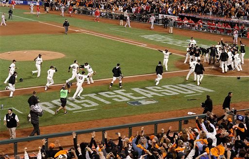 San Francisco Giants' Travis Ishikawa (45) heads for home on a walk-off three-run home run against the St. Louis Cardinals in Game 5 of baseball's NL Championship Series, Thursday, Oct. 16, 2014, in San Francisco.