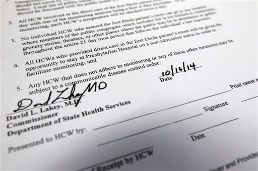 This Friday, Oct. 17, 2014, in Dallas, photographs shows an excerpt from a Texas Department of State Health Services document that healthcare workers with possible exposure to Ebola are being asked to sign.