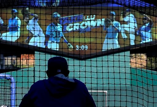 Kansas City Royals manager Ned Yost watches batters during baseball practice Friday, Oct. 17, 2014, in Kansas City, Mo. The Royals are to host the San Francisco Giants in Game 1 of baseball's World Series on Oct. 21. (AP Photo/Charlie Riedel)