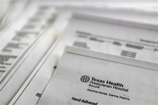 This Friday, Oct. 10, 2014, file photo, shows a copy of Thomas Eric Duncan's medical records from Texas Health Presbyterian Hospital, provided by Duncan's family to The Associated Press.