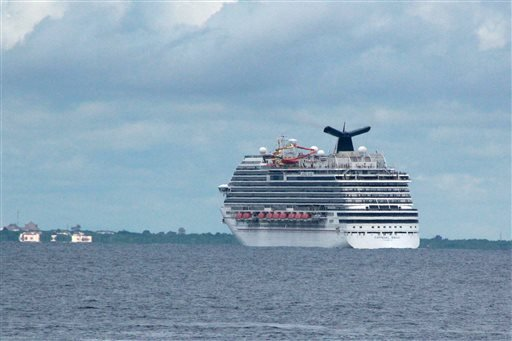 The cruise ship Carnival Magic passes near Cozumel , Mexico, in this Friday, Oct. 17, 2014 file photo.