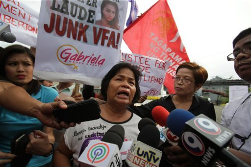 In this Saturday, Oct. 18, 2014 photo, Julita Cabillana, mother of killed transgender Jennifer Lauda, talks to reporters during a rally near the USS Peleliu, where U.S. Marine Pfc. Joseph Scott Pemberton is said to be held, at the Subic Bay free port.