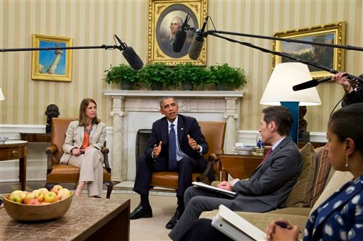This Oct. 16, 2014, file photo shows President Barack Obama speaking to media during a meeting with his Ebola response team in the Oval Office of the White House.