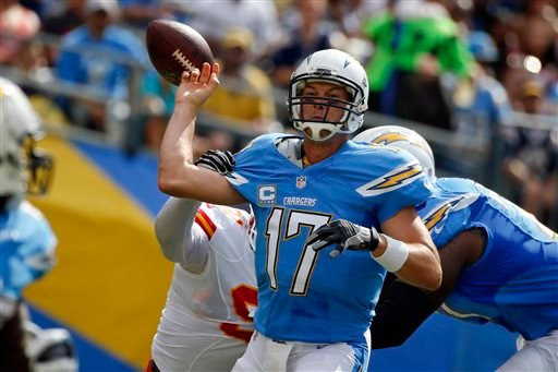 San Diego Chargers quarterback Philip Rivers (17) is hit on the throwing arm by Kansas City Chiefs outside linebacker Tamba Hali during the first half of an NFL football game Sunday, Oct. 19, 2014, in San Diego. (AP Photo/Lenny Ignelzi)
