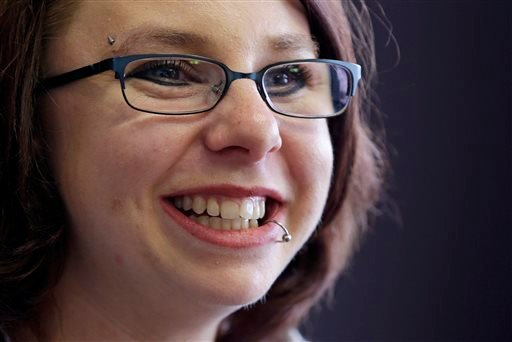 In this Thursday, June 26, 2014, file photo, Michelle Knight smiles during an interview in Cleveland.