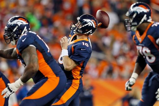 Denver Broncos quarterback Peyton Manning (18) throws his 510th career touchdown pass during the first half of an NFL football game against the San Francisco 49ers, Sunday, Oct. 19, 2014, in Denver. (AP Photo/Joe Mahoney)