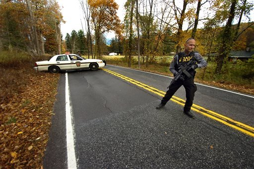 A Pennsylvania State Trooper patrols along a closed section of Lower Swiftwater Road on Saturday, Oct. 18, 2014, during a massive manhunt for killer Eric Frein in Swiftwater, Pa. (AP Photo / The Scranton Times-Tribune, Butch Comegys)