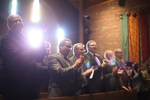 The front row of the church clapped along with the singing of the Community Worship Team Sunday afternoon Oct. 19, 2014, during a memorial service at Cross of Glory Lutheran Church in Brooklyn Center, Minn.