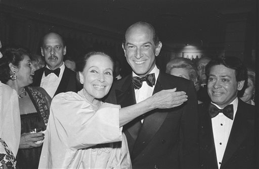 In this May 7, 1981, file photo, fashion designer Oscar de la Renta and actress Dolores del Rio are pose at the Casita Maria Benefit dinner at the Pierre Hotel in New York where the two were honored.