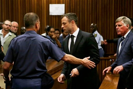 Oscar Pistorius, center, is led out of court in Pretoria, South Africa, Tuesday, Oct. 21, 2014.