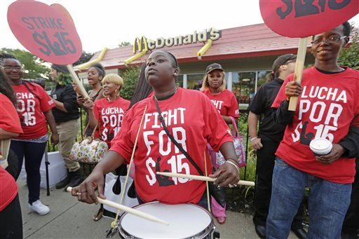 In this Sept. 14, 2014 file photo, protesters participate in a rally outside a McDonald's on Chicago's south side as labor organizers escalate their campaign raise the minimum wage for employees to $15 an hour.