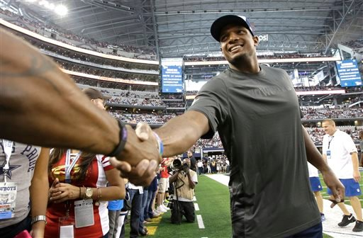 FILE - In this Sept. 7, 2014, file photo, Dallas Cowboys' Michael Sam shakes hands with fans before the first half of an NFL football game against the San Francisco 49ers in Arlington, Texas. (AP)