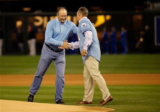 Oct. 14, 2014 file photo: Former Kansas City Royals' Bret Saberhagen, left, and George Brett shake hands before Game 3 of the American League baseball championship series against the Baltimore Orioles. (AP Photo/Matt Slocum , File)