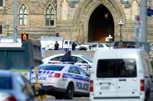 Police converge on Parliament Hill in Ottawa on Wednesday Oct. 22, 2014. (AP)