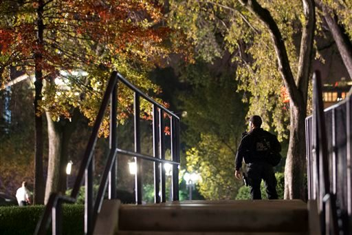 Secret Service respond on the North Lawn of the White House after a man jumped the White House fence, Wednesday, Oct. 22, 2014, in Washington. (AP)