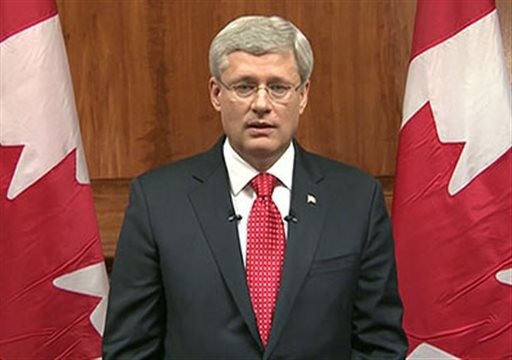 In this frame grab taken from video, Canada Prime Minister Stephen Harper speaks during a televised address to the nation in Ottawa, Ontario, Wednesday, Oct. 22, 2014. (AP Photo/APTN, Pool)