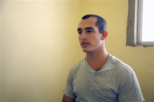 This May 3, 2014, photo shows Sgt. Andrew Tahmooressi left, who is being held at Tijuana's La Mesa Penitentiary. (AP Photo/UT San Diego, Alejandro Tamayo)