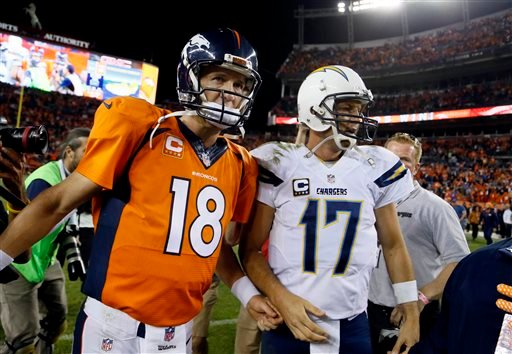 Denver Broncos quarterback Peyton Manning (18) greets San Diego Chargers quarterback Philip Rivers (17) after an NFL football game, Thursday, Oct. 23, 2014, in Denver. The Broncos won 35-21. (AP Photo/Jack Dempsey)