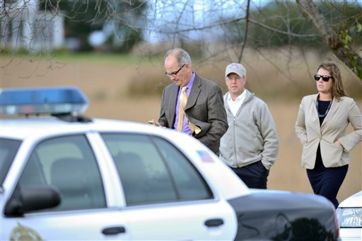 Mayor Randy McClement, left, arrives at the scene of a mid-air collision between an airplane and a helicopter near the Frederick Municipal Airport Thursday, Oct. 23, 2014, in Frederick, Md.